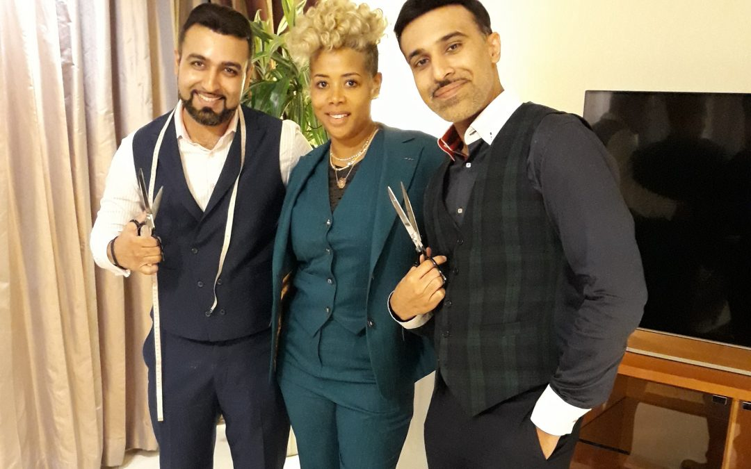 "Kelis – Singer of the all time hit song ""MilkShake"" wears a turquoise green three piece bespoke suit tailored by Knights and Lords Bespoke tailors in Dubai"